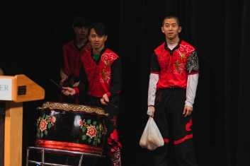 "Guest artists play the drums in the ""Lion Dance""."