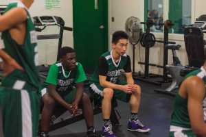 Quinton Nsamba '21 and Leo Wen '21 listen to their coaches during halftime.