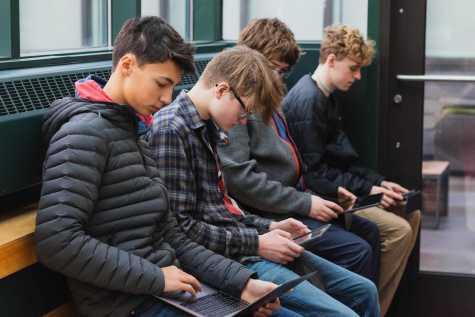 Student engage with their devices rather than each other during a free period.