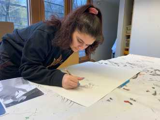 Liyanah Naji '23 draws a hand in Drawing I.
