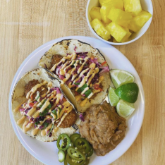 Coconut Crusted Red Fish ( locally caught) with a Red Cabbage Slaw, Sriracha Aioli, Refried Beans, Pickled Jalapeños and Fresh Pineapple. Photo courtesy of the @brimmer_eats Instagram.