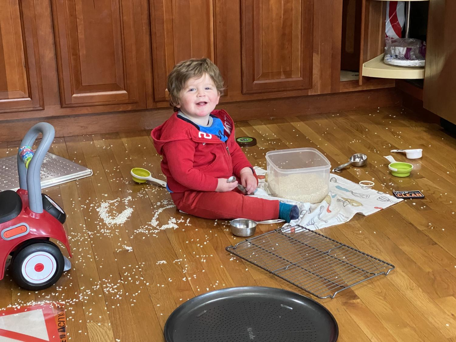 History teacher David Cutlers young son makes a mess in the kitchen while dad and mom, also a teacher, Zoom with students. The picture speaks for itself.