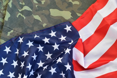 American flag and folded military uniform jacket. Photo purchased from BigStock.com.