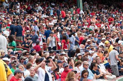 Boston - August 8: New York Yankees and Boston Red Sox fans in the stands on August 8 2011 at Fenway Park in Boston. Photo purchased from BigStock.com.