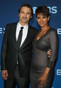 "2/37 SLIDES | Halle Berry and Olivier Martinez split in 2015 after two years of marriage. In a joint statement on Oct. 27, the couple said, ""It is with a heavy heart that we have come to the decision to divorce. We move forward with love and respect for one another and the shared focus for what is best for our son. We wish each other nothing but happiness in life, and we hope that you respect our, and most importantly our children's privacy, as we go through this difficult period."" Less than a year later, however, a judge handling their divorce noted no action had been taken. According to the New York Post, Halle was not sure she wanted to go through with it, although they had not gotten back together as a couple."