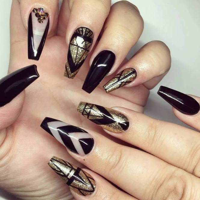 Black And White Nail Art Design With Gold Stripes Embellishments