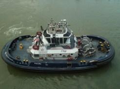 Tugs guide ship into the lock
