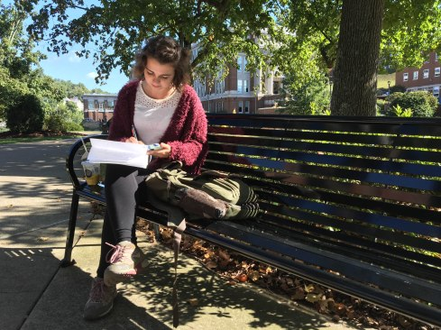 Samantha Holm takes a moment between classes to finish a homework assignment on Sept. 27, in Morgantown, W. Va. The assignment was for a geography class at West Virginia University. Photo by Blaithe Tarley.