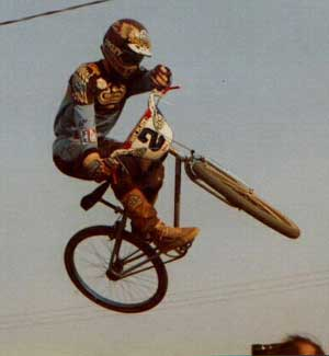 This was a jump in the second turn at Kings BMX in Modesto.. The head in the bottom of the shot is Sandy Finkleman, Owner of Wheels and Things , and Team Manager of Diamond Back at the time; 1982