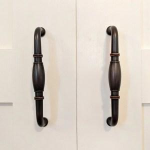 Brass closet handles on cream French closet doors