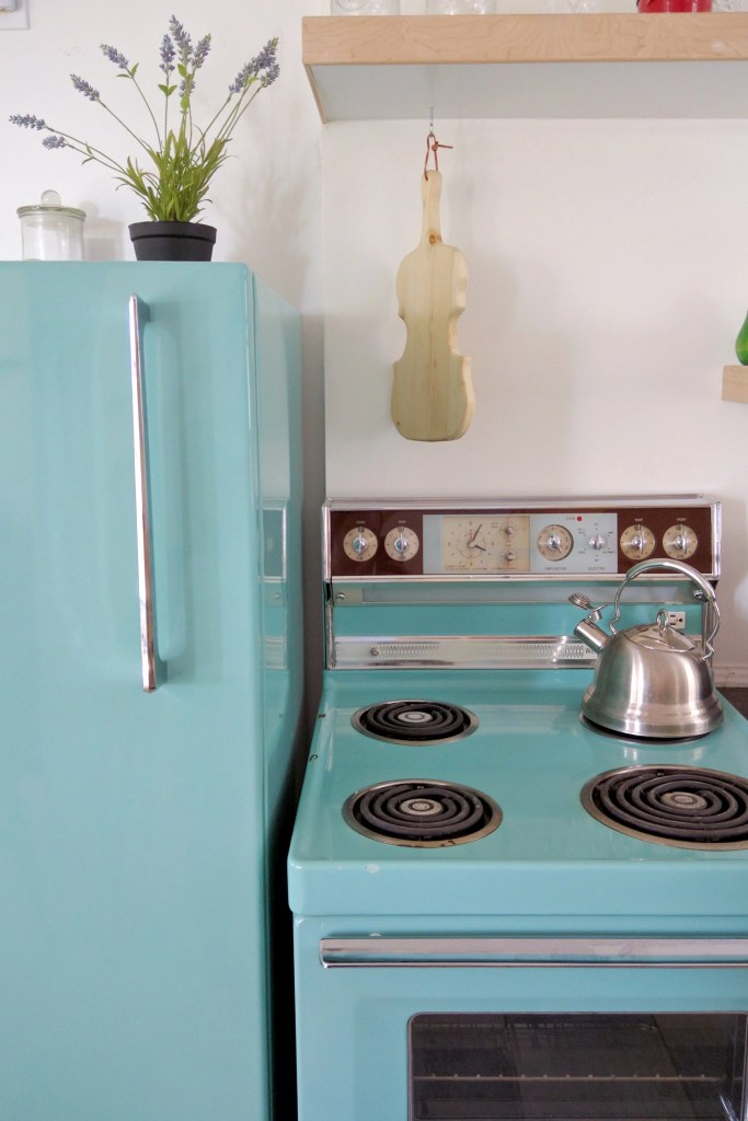 50s teal appliances and a fiddle cutting board in Saskatoon