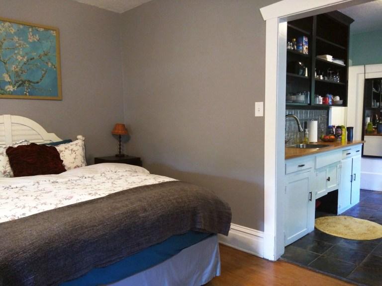 beautiful bedroom next to kitchen