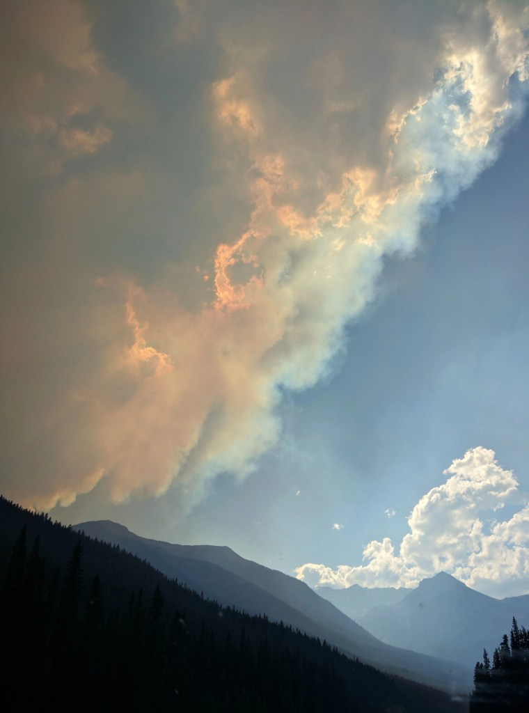 mountains in banff national park smoke from fire