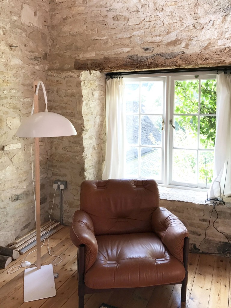 chair by cottage window