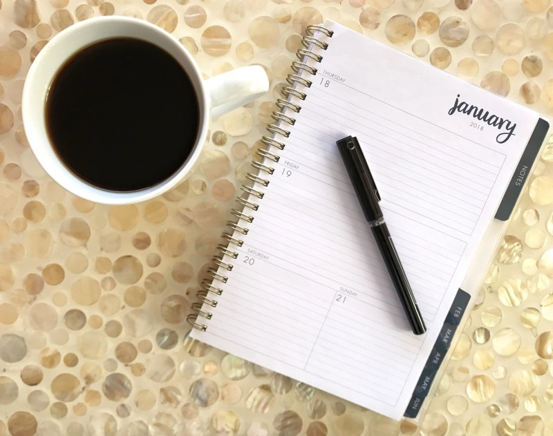 coffee cup and personal calendar