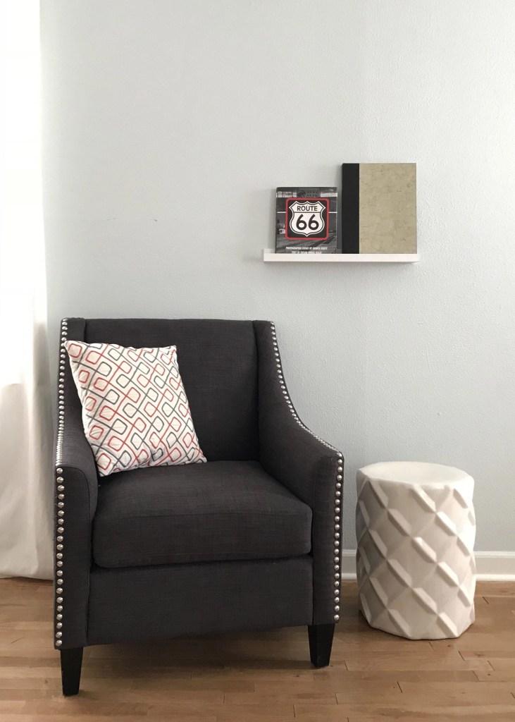 a chair with a bookshelf