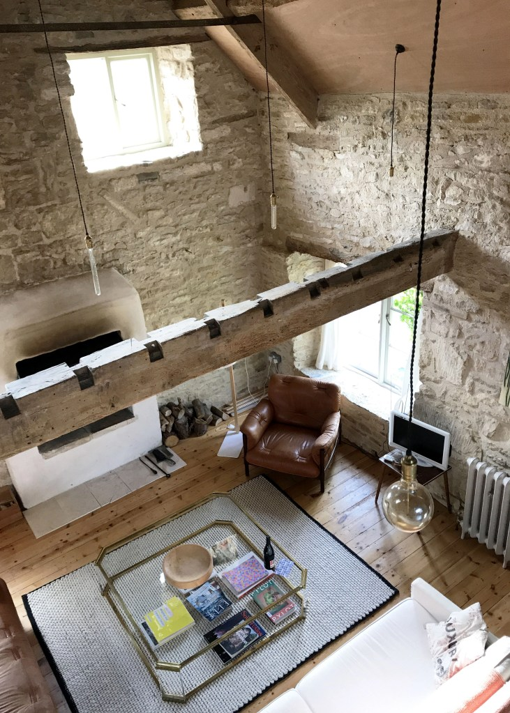 topdown view of a living room with exposed beams