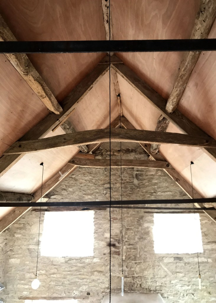 rafters above a renovated loft