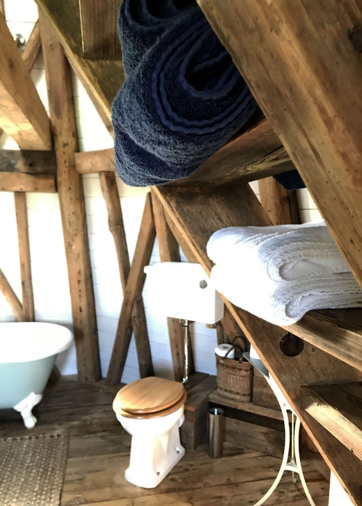 towels stacked on old ladder