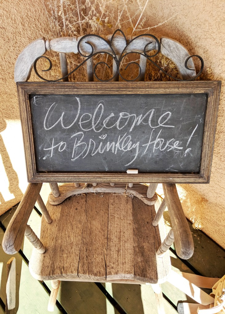 welcome sign for brinkley house airbnb