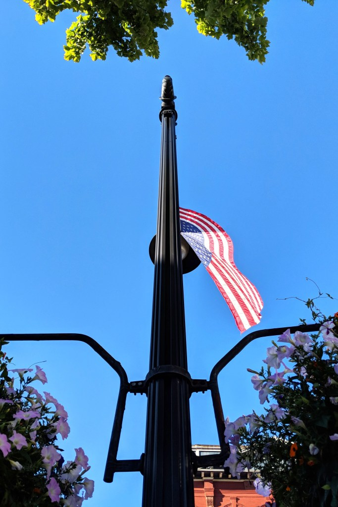 Littleton, New Hampshire - American Flag and Flowers