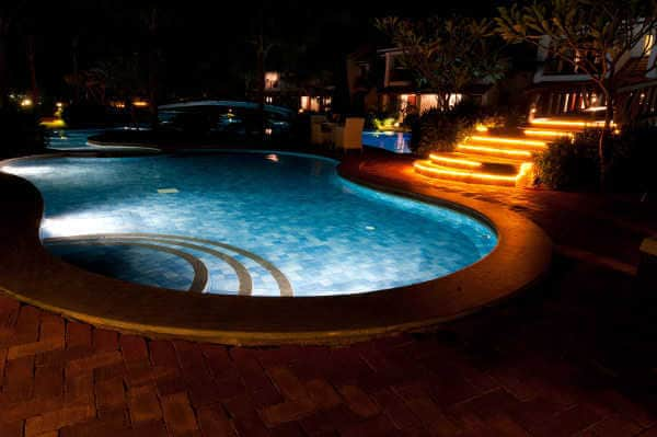 Swimming pool lit from inside and outside