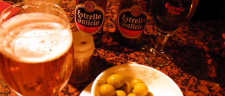 Olives and Estrella Galicia in a shady bar in London