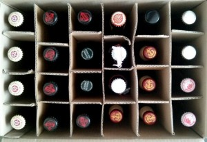 An assortment of beers in a box.