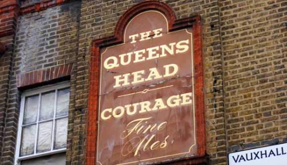 A knackered old pub sign.