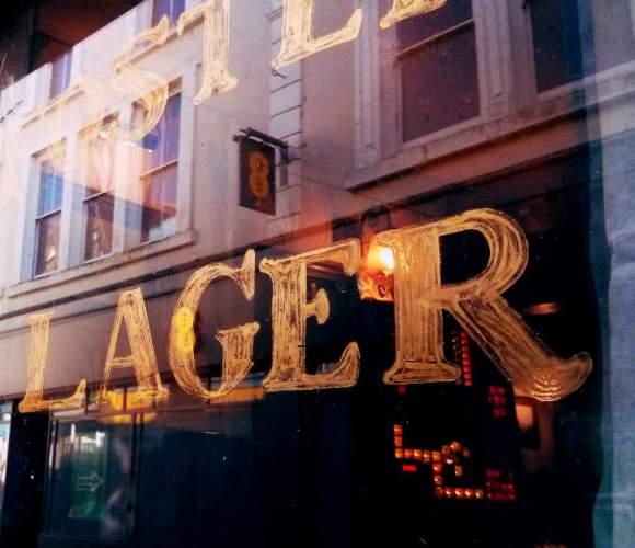 Lager written on a pub window.