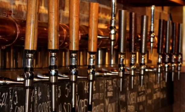 Beer taps at the Samuel Jones, Exeter.