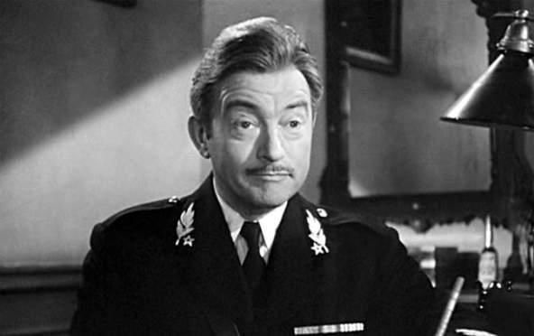 Claude Raines as Renault in Casablanca (1942).