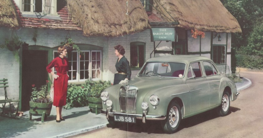 MG Magnette parked outside a pub, with two female models.