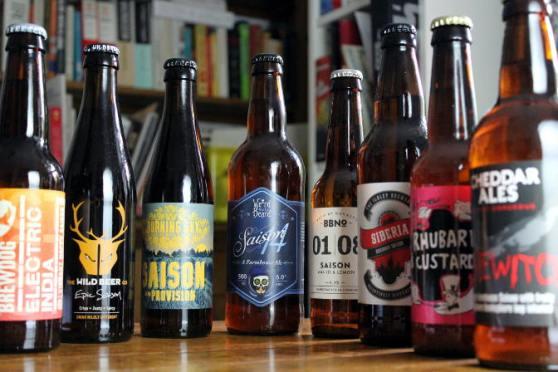Saison bottles in a row.