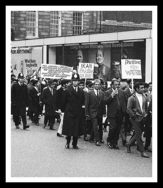 Steve Rosson's shot of protesters marching in front of a Watney's Red Revolution poster c.1969.