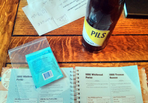 Homebrewing yeast, book, notes and bottle.