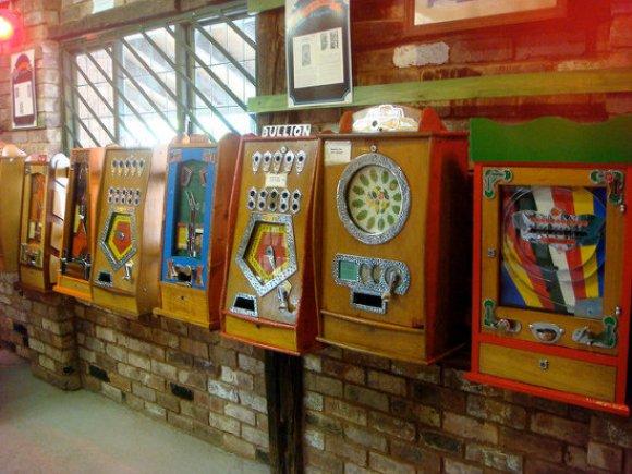 A line of vintage slot machines.