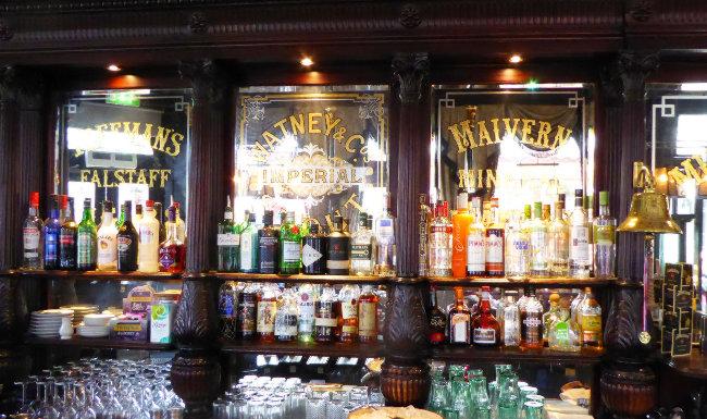 Victorian mirrors behind a pub bar.