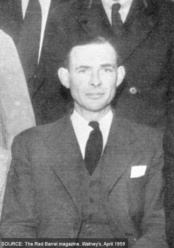 Black and white portrait of a man in a three-piece suit.