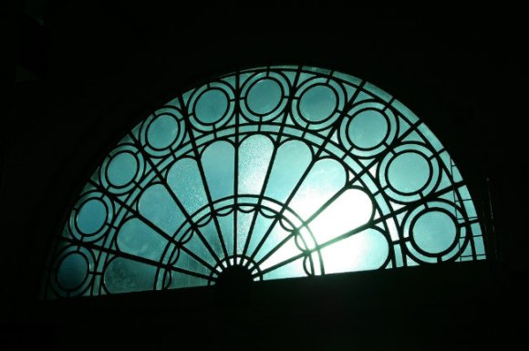 Blue stained window in silhouette.
