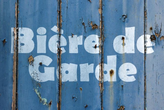 Illustration: Biere de Garde text on weathered wood.