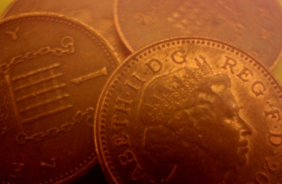 Macro shot of 1p pieces with The Queen's profile.