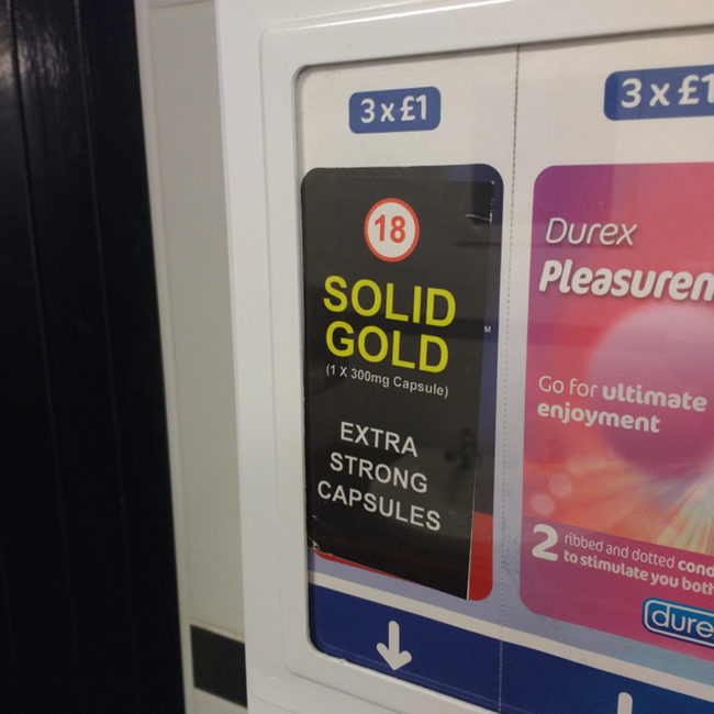 Solid Gold vending machine in a pub toilet.
