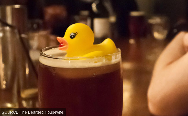 A rubber duck in a pint of beer.
