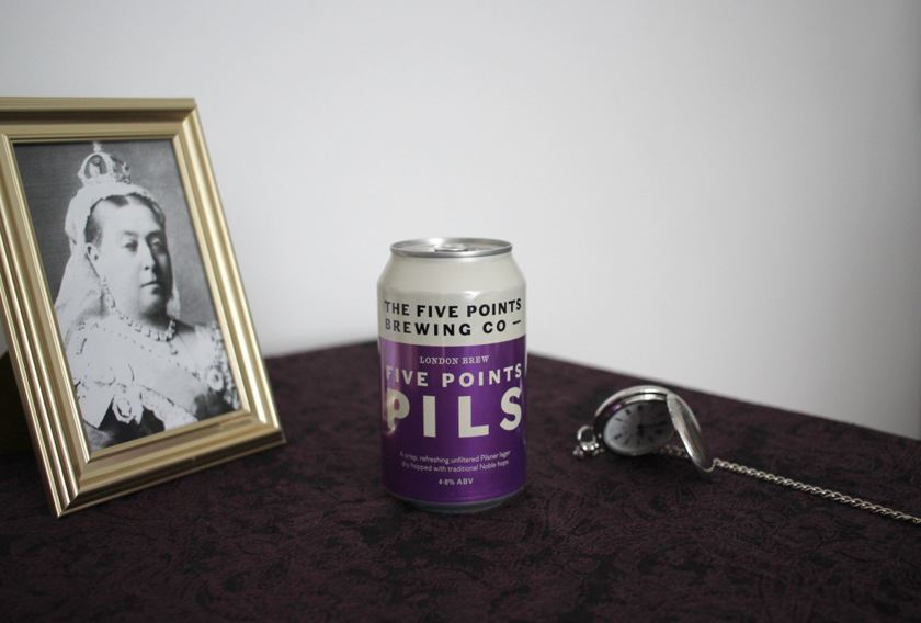 Still life: Five Points Pils in the can, with Queen Victoria and a pocket watch.
