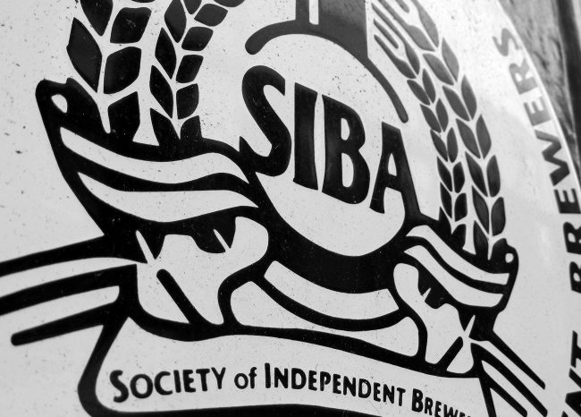 Vintage SIBA sign on a pub in London.