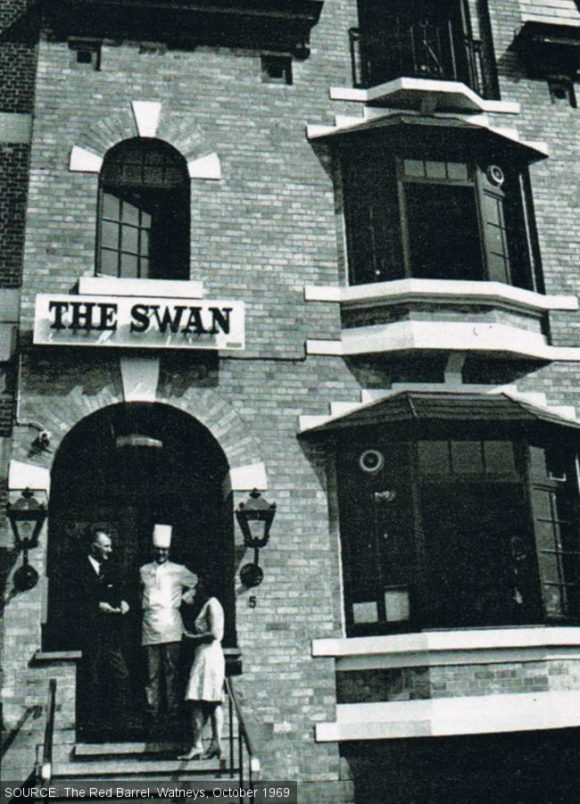 The Swan with staff outside the door.