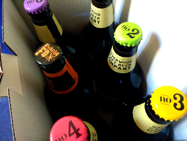The numbered caps of the Hatherwood beer box.