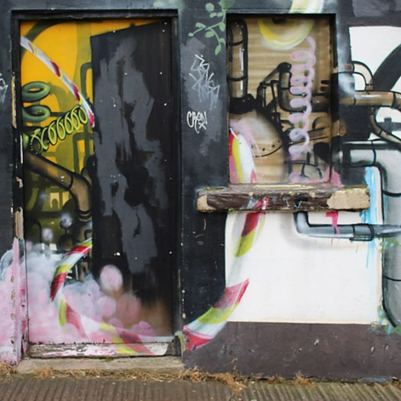 Doorway with painted pipes and steam.