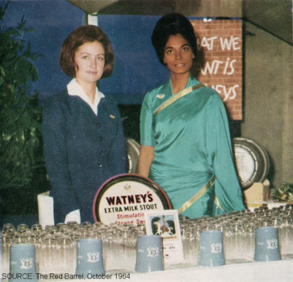 Two women with Watney's beers.